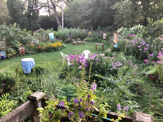 Garden Party in Mary's backyard with six artists artwork displayed