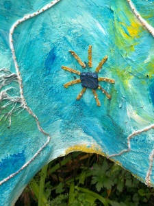 After the rain, Blue watercolor cake sewn on weathered art panel.