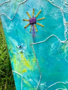 After the rain, Violet watercolor cake sewn on weathered art panel.