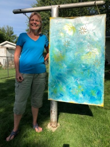 First location for weathering art panel, Cedar Falls, Iowa. Hanging from clothesline post in backyard.